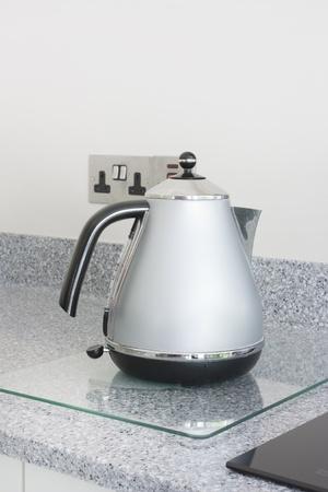 worktop: modern grey metal kettle stood on a granite worktop