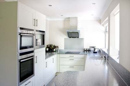 new white modern kitchen and stainless steel appliances photo