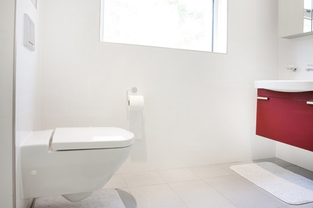 Modern bathroom with wall hung toilet and sink unit photo