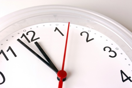 seconds: ticking clock seconds nearly 12 pm or 12am Stock Photo