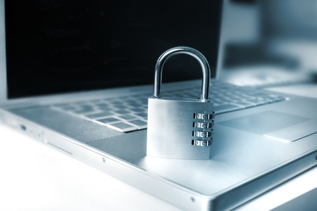 laptop and padlock as a metaphor for secure systems and computing Stock Photo - 9743364