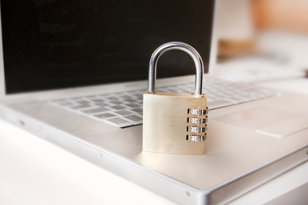 laptop and padlock as a metaphor for secure systems and computing Stock Photo - 10451330