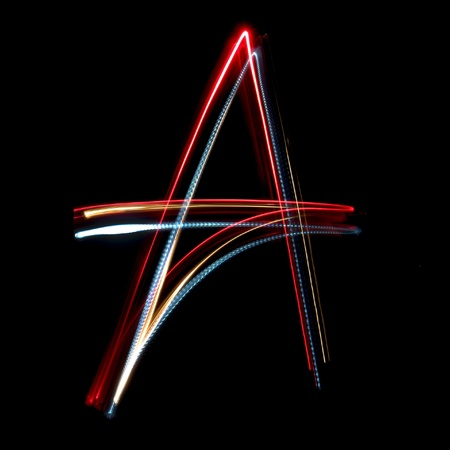 Letter A on a black background made with light painting torches Stock Photo