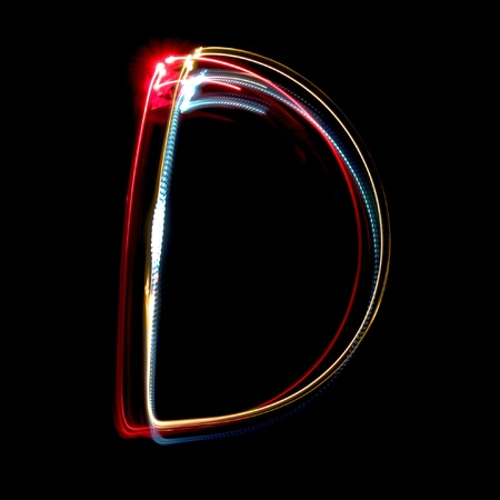 Letter D on a black background made with light painting torches Stock Photo - 11438581