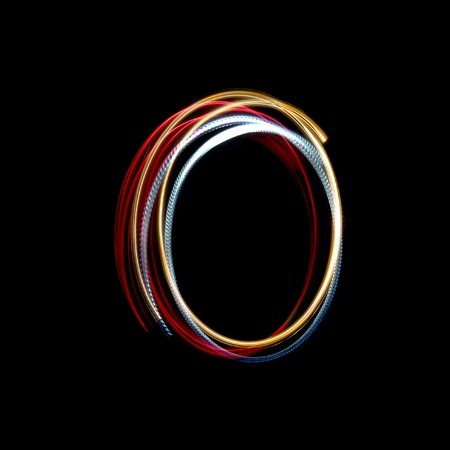 Letter O on a black background made with light painting torches photo