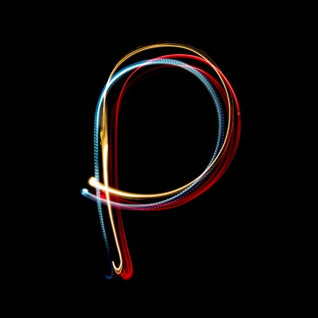 Letter P on a black background made with light painting torches photo