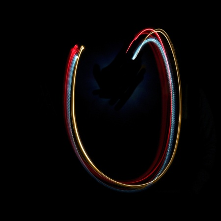 torches: Letter U on a black background made with light painting torches Stock Photo