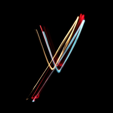 Letter Y on a black background made with light painting torches photo