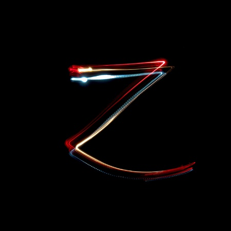Letter Z on a black background made with light painting torches photo
