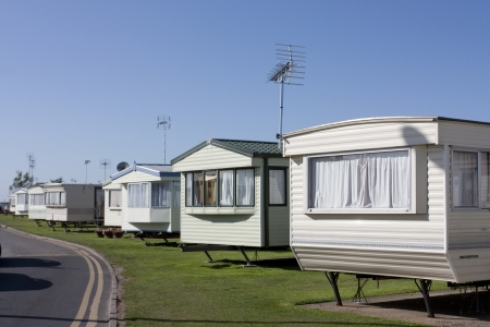 static: a row of static caravans on a typical british summer holiday park