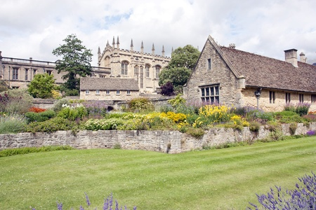 summer gardens with lavendar bushes and old stone cottage in oxford photo
