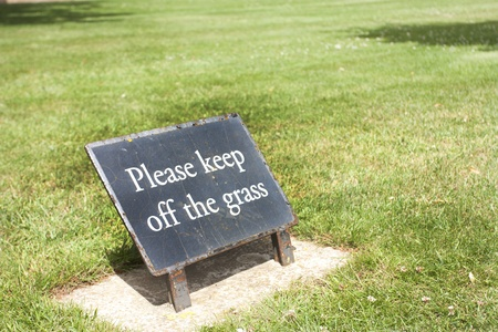 please keep off the grass sign on the grass in summer Stock Photo - 12173928