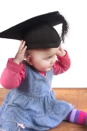 graduacion niños: analogía o metáfora para el éxito adn educación de los niños pequeños Foto de archivo