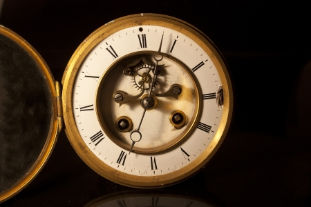 showing the face and dial of an old antique british victorian clock photo