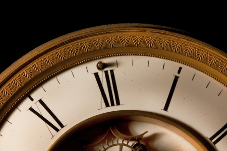 12 o'clock: Focus on the roman numerals of an old antique victorian clock Stock Photo