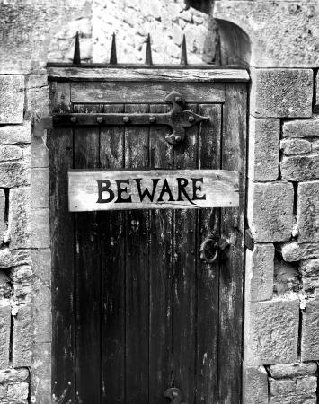 beware: door to a dungeon or forbidden secret room