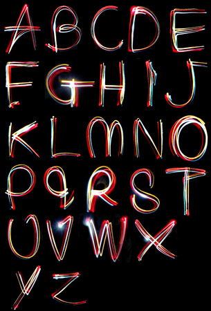 letter q: alphabets written in the dark with torches and lasers
