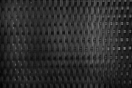 black plastic woven furniture texture close up pattern