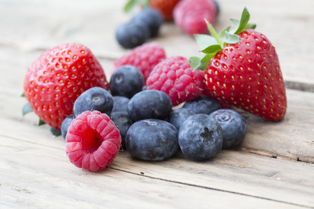 natural shot on old wooden background of summer berries