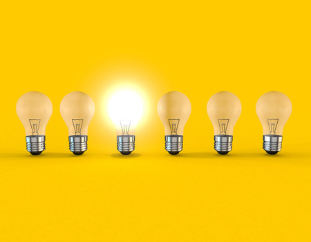 lit: A line of lightbulbs with only one lit Stock Photo