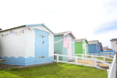 ouside: row of colourful beachhuts