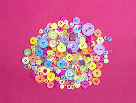 collection of a range of different coloured buttons for a poster or web background Stock Photo