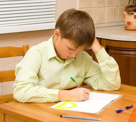 Young boy doing his homework photo