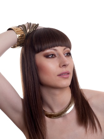 Attractive brunette with a egyptian style make up and hair  Golden jewellery on her neck  Stock Photo - 13875538