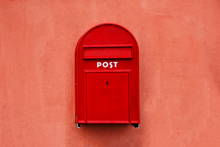 mail service: Red Mail box at wall