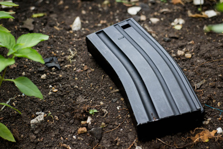 M16: Airsoft gun magazine on the ground Stock Photo