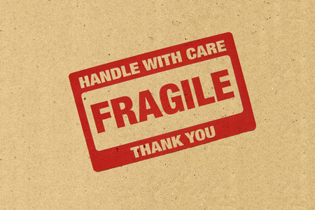 fragile industry: Close up of fragile on Brown paper