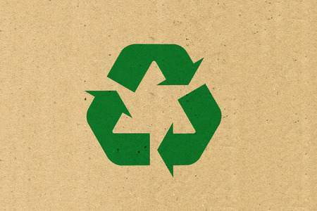 brown paper: Recycle logo on brown paper Stock Photo