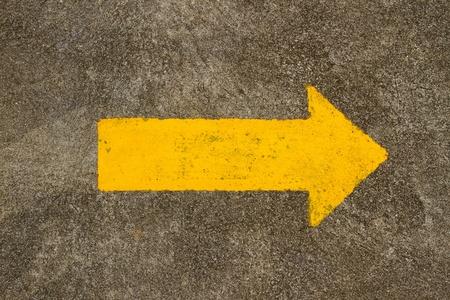 Traffic arrow sign on the floor