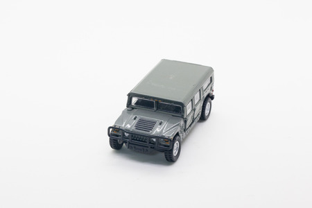 green plastic soldiers: military vehicle toy isolate on white background