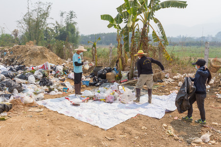environmental sanitation: PAI, THAILAND - April 10, 2016 : Councils officer prepare Screeners in the garbage disposal pond in Pai,Thailand