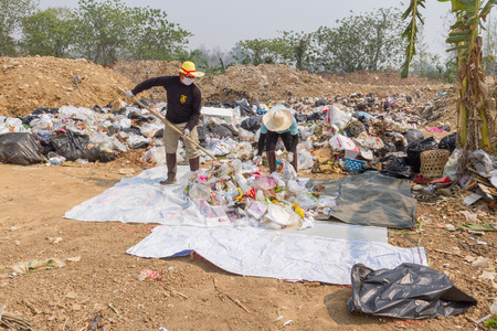 councils: PAI, THAILAND - April 10, 2016 : Councils officer prepare Screeners in the garbage disposal pond in Pai,Thailand
