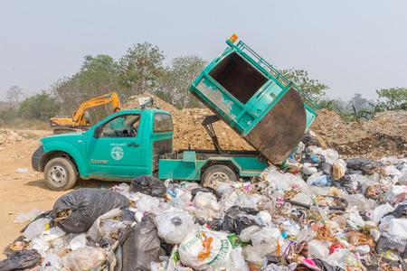 environmental sanitation: PAI, THAILAND - April 10, 2016 : Garbage truck of Pai Subdistrict Administrative Organization dumping Garbage at the garbage disposal pond in Pai,Thailand