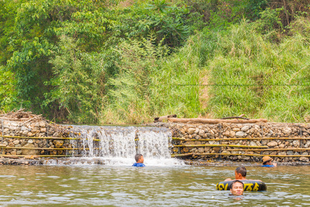 weir: PAI, THAILAND - April 13, 2016 : Many people swimming at the small weir irrigate in the Pai Thailand Editorial