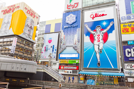 famous industries: Osaka, Japan - DEC 8, 2015: Glico billboard is an icon of Dotonbori, a famous tourist destination for nightlife and entertainment area in Osaka, Japan. Editorial