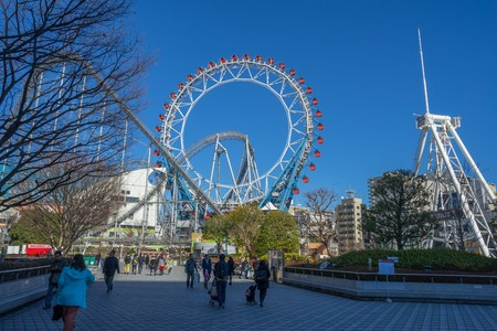 Tokyo, Japan - 17 February 2017: Ferris wheel and roller coaster at Tokyo Dome city Amusement Park