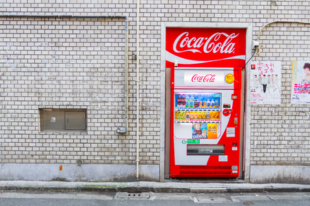 capita: TOKYO, JAPAN DEC 8, 2015 : Vending machines of various company in Tokyo on 8 december 2015. Japan has the highest number of vending machine per capita in the world at about one to twenty three people.