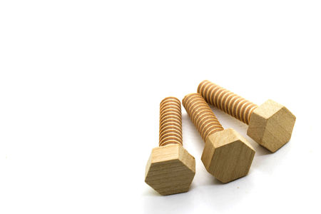 bolts and nuts: Wooden nuts and bolts with space for text on white background