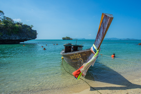 KRABI THAILAND 3 FEB 2018: Longtail boats anchored at the Island in Krabi Province Thailand. Phi Phi is part of Mu Ko Phi Phi National Park. Publikacyjne