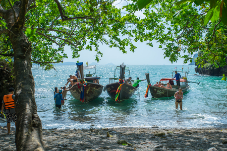 KRABI THAILAND 3 FEB 2018: Long tail boats anchored waiting for trourist at the Hong Island in Krabi Province Thailand. Phi Phi is part of Mu Ko Phi Phi National Park.
