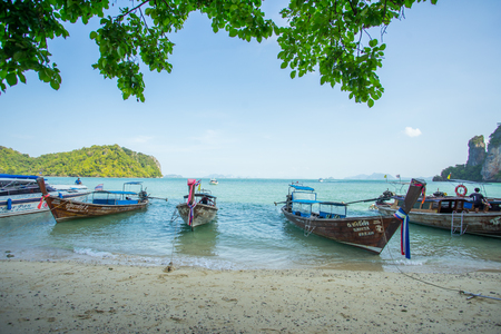 KRABI THAILAND 3 FEB 2018: Longtail boats anchored at the Island in Krabi Province Thailand. Phi Phi is part of Mu Ko Phi Phi National Park. Stock Photo