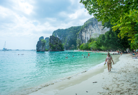 KRABI THAILAND 3 FEB 2018: Many people swimming and relaxing at Railay Island in Krabi Province Thailand. Phi Phi is part of Mu Ko Phi Phi National Park Publikacyjne