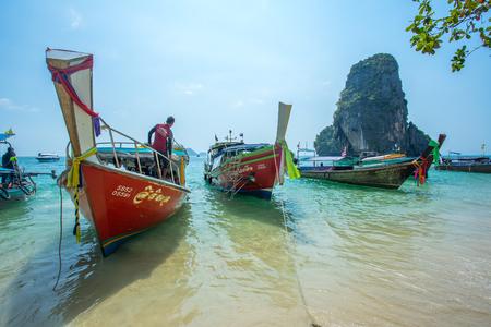 KRABI THAILAND 3 FEB 2018: Longtail boats anchored at the Hong Island in Krabi Province Thailand. Phi Phi is part of Mu Ko Phi Phi National Park Editorial