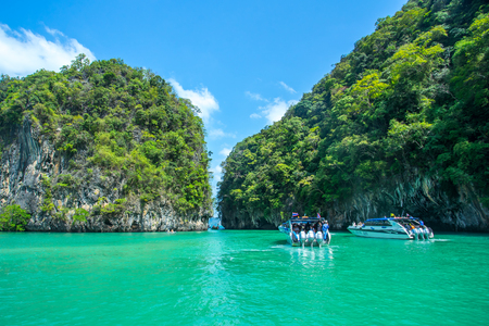 Longtail boats anchored near the big mountain at the Hong Island in Krabi Province Thailand