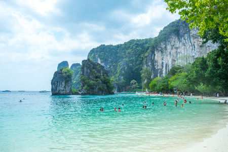 KRABI THAILAND 3 FEB 2018: Many people swimming and relaxing at Railay Island in Krabi Province Thailand. Phi Phi is part of Mu Ko Phi Phi National Park Editorial