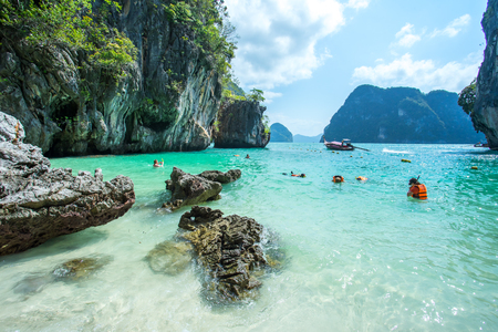 KRABI THAILAND 3 FEB 2018: Many people swimming and diving at the Hong Island in Krabi Province Thailand. Phi Phi is part of Mu Ko Phi Phi National Park